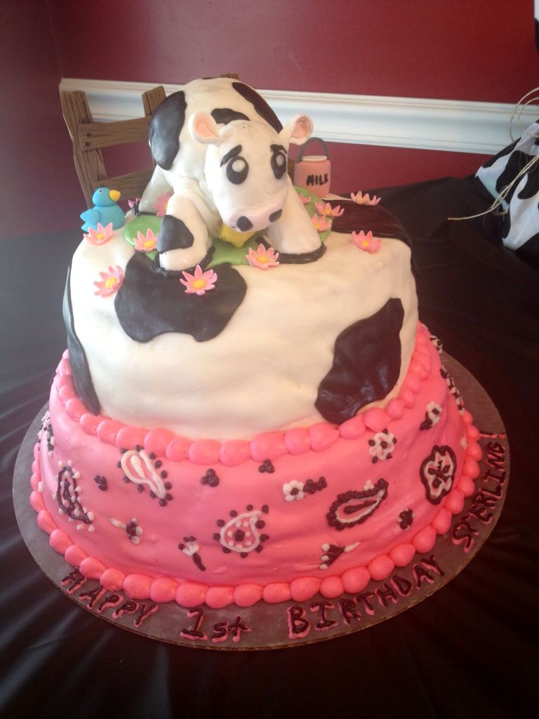 Country girl's first birthday cake. 2-tier pink, paisley, and cow on a farm.  (Was trying out that marshmallow fondant for the first time and it made the cake lumpy and sag)