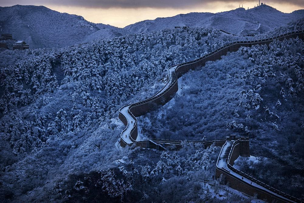 24 NOV: Snow settles on the Great Wall near Beijing. Chinas capital and the northern part of the country were dusted with snow as winter set in.  The earliest known stages of the Great Wall were built in the 5th Century BC but not linked and extended until the Qin Dynasty between 221-206 BC. Much of the remaining sections seen today were largely rebuilt during the Ming Dynasty (1368-1644). The Wall was built as a defence against invasions from the north and is estimated to have stretched…
