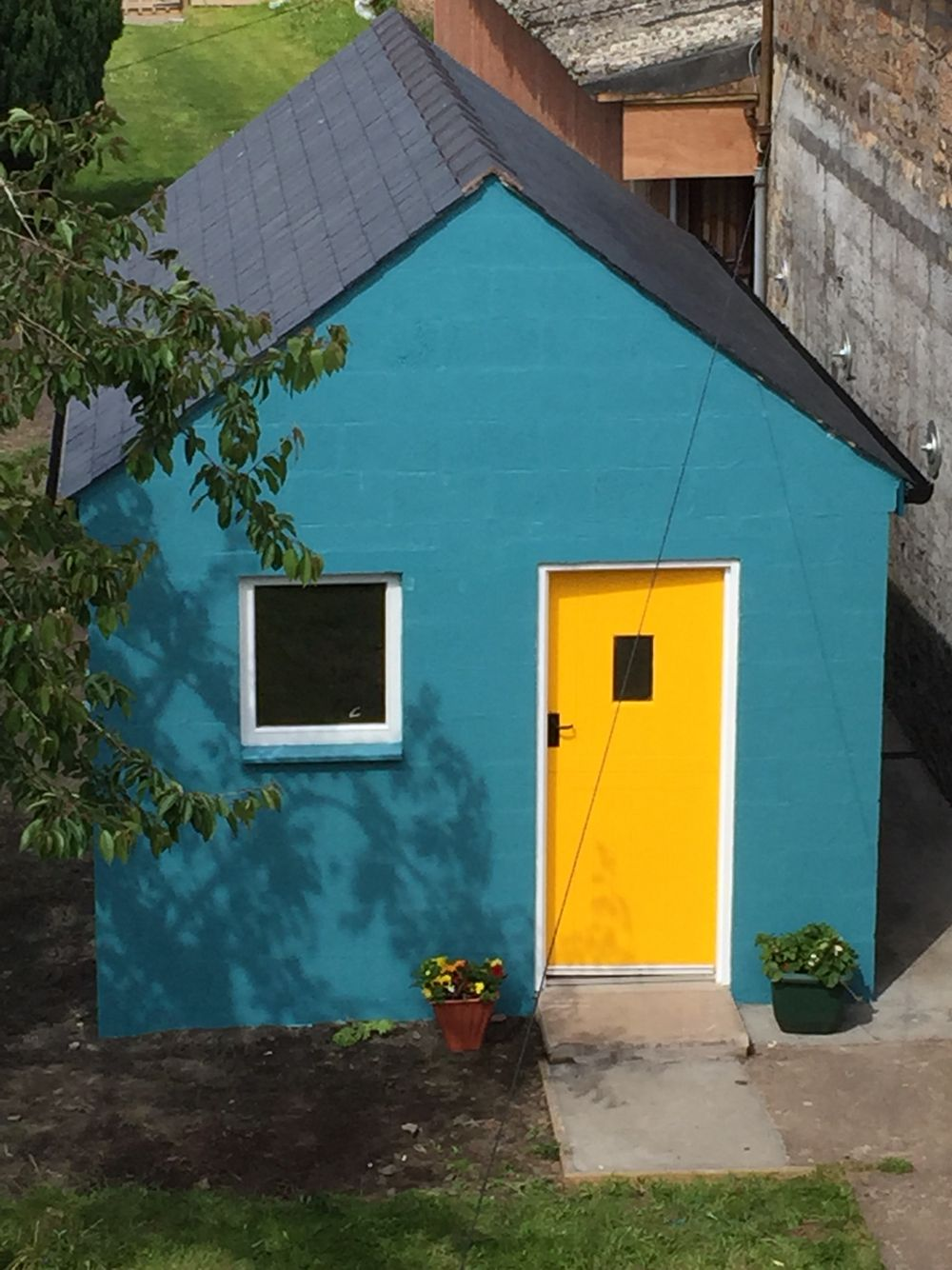 My almost finished craft room/ workshop with the gorgeous yellow door!