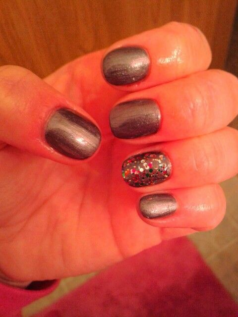 Silvery purple nails with sparkle on ring finger
