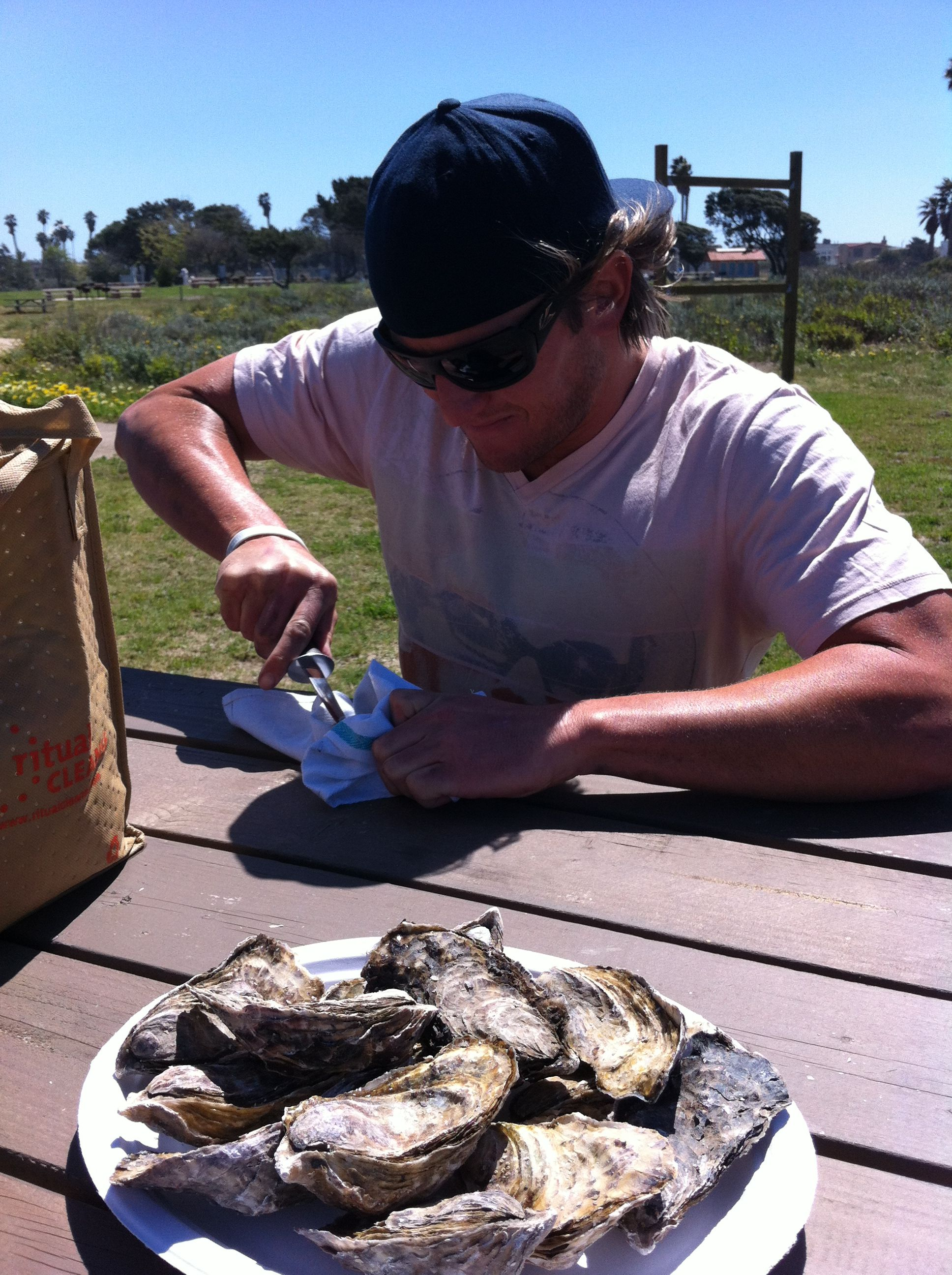 Shucking my own oysters at the Jolly Oyster Truck in Ventura, CA.  The Jolly Oyster, Ventura State Beach, Pacific Oysters http://www.thejollyoyster.com/