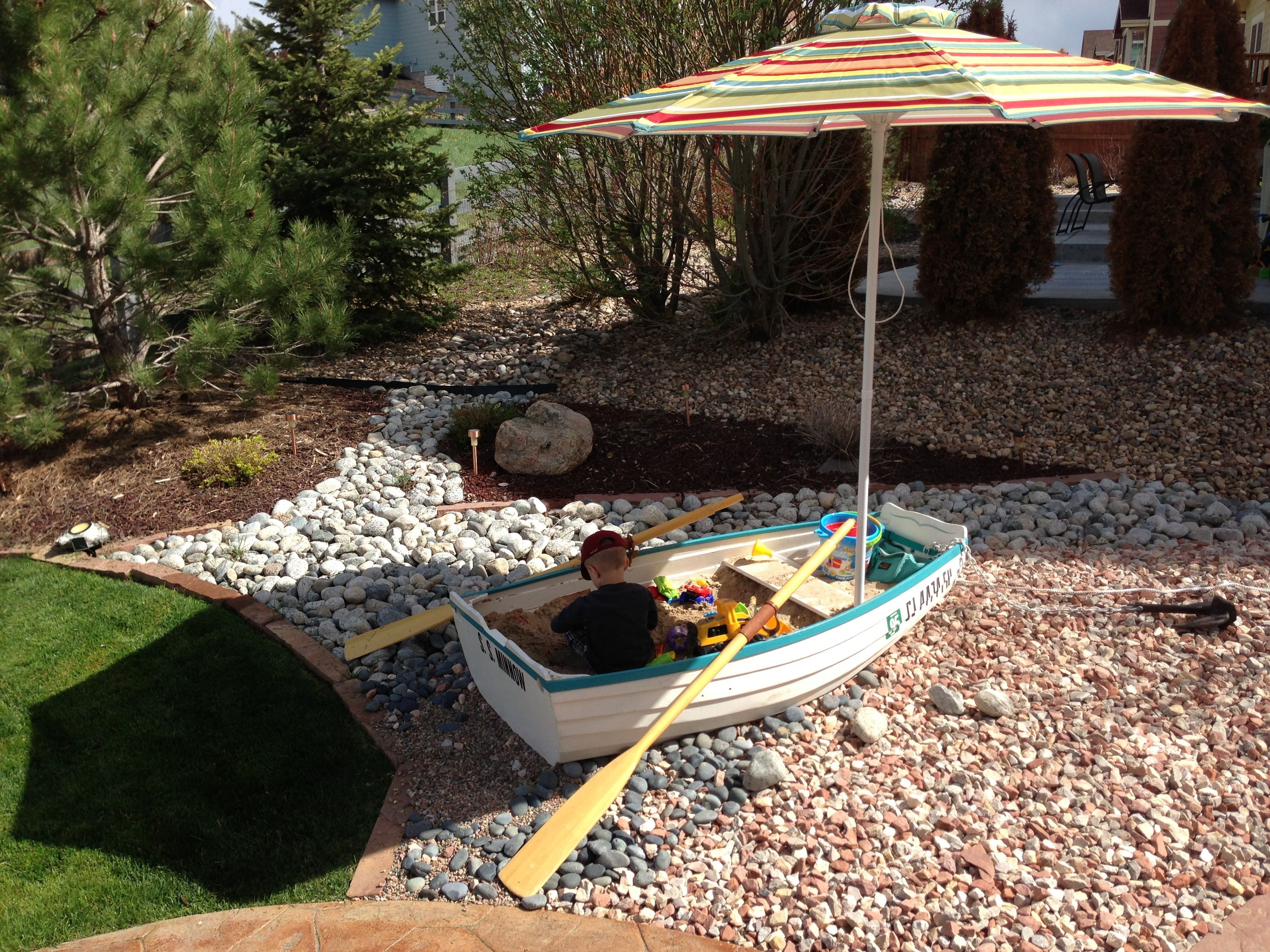 Homemade dinghy turned into sandbox didn 39 t have a good for Garden design troller boat