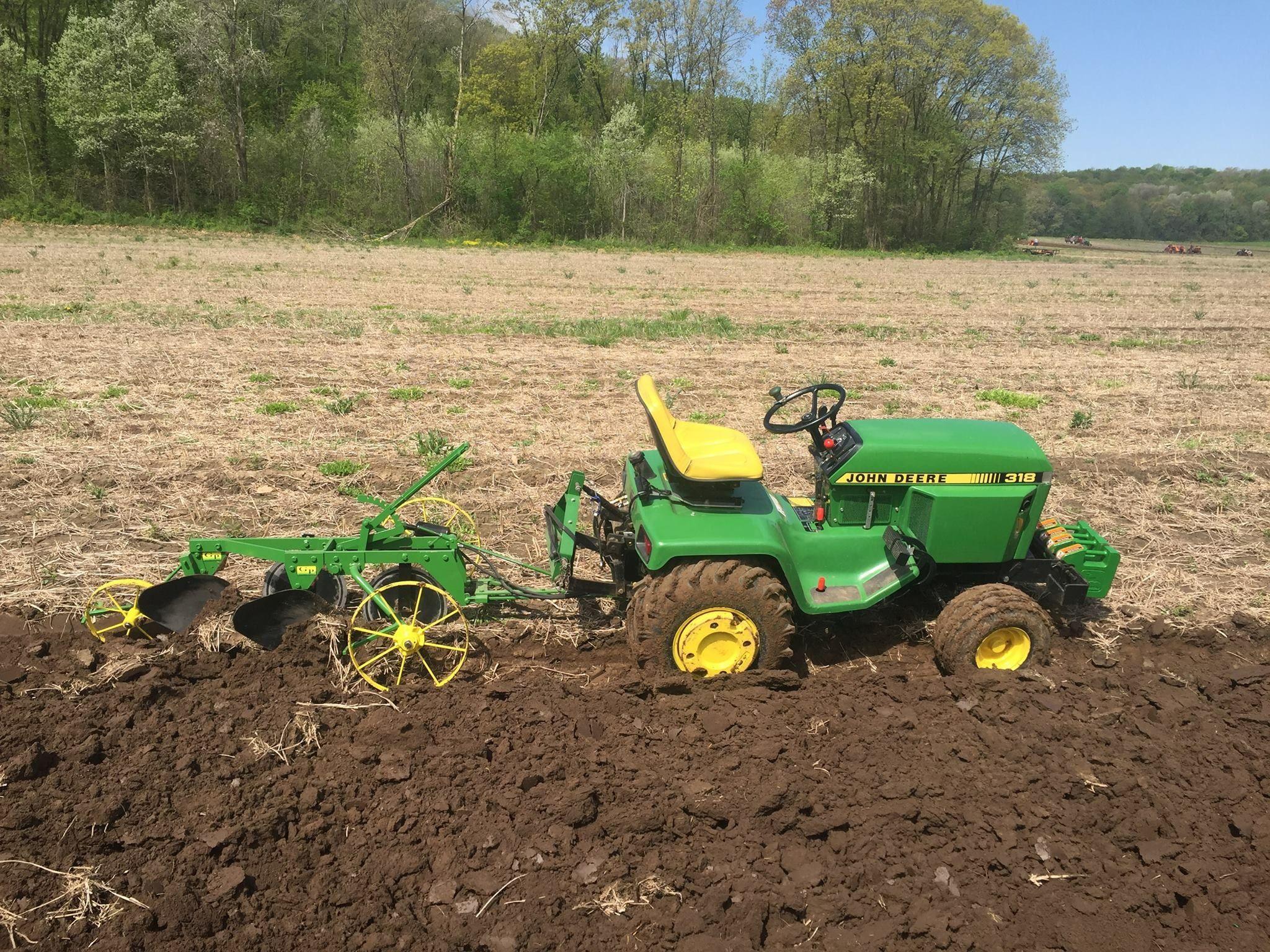 John Deere 318 garden tractor with breaking plow | John