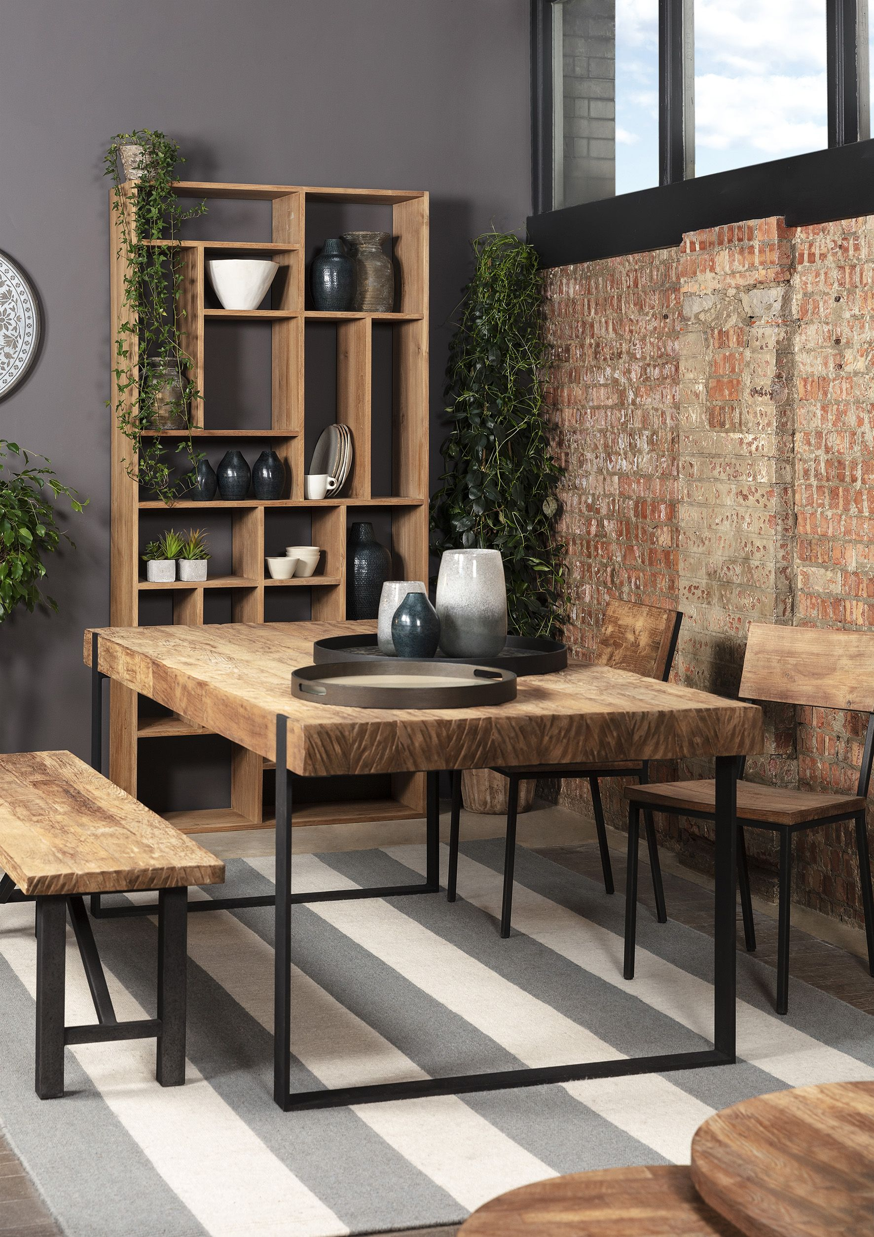 Baxter Sawn Dining Table Crafted in solid teak and vintage iron the Baxter Sawn