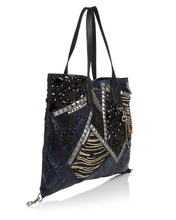 23d34b76caa3 Leave it to Marc Jacobs to trick out your every day tote with exotic  embossed snakeskin