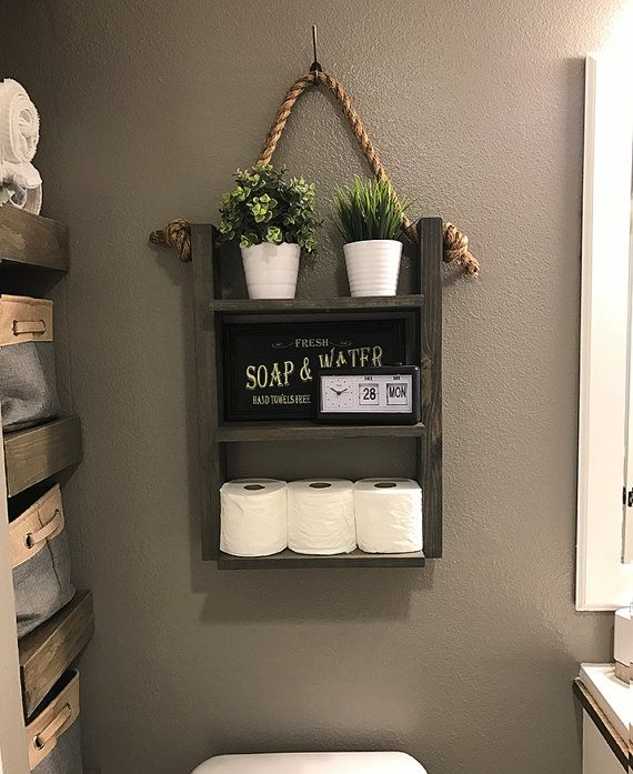 and Rope Ladder Shelf The Hanging Rope & Ladder Shelf will make a statement in any home with its rustic yet modern flare and can be utilized anywhere in your house without worry. It works great as additional storage for your bathroom, hanging in your kitchen as a spice rack, or in your laundry room for supplies. Built with solid wood to last. ♦ DIMENSIONS ♦ 25 High 18 Wide (Shelves - 15) 5.5 Deep ♦ STYLE ♦ Rustic Farmhouse Decor ♦ LISTING PHOTO STAIN/FINISH & SIZE ♦ Carbon Gra...
