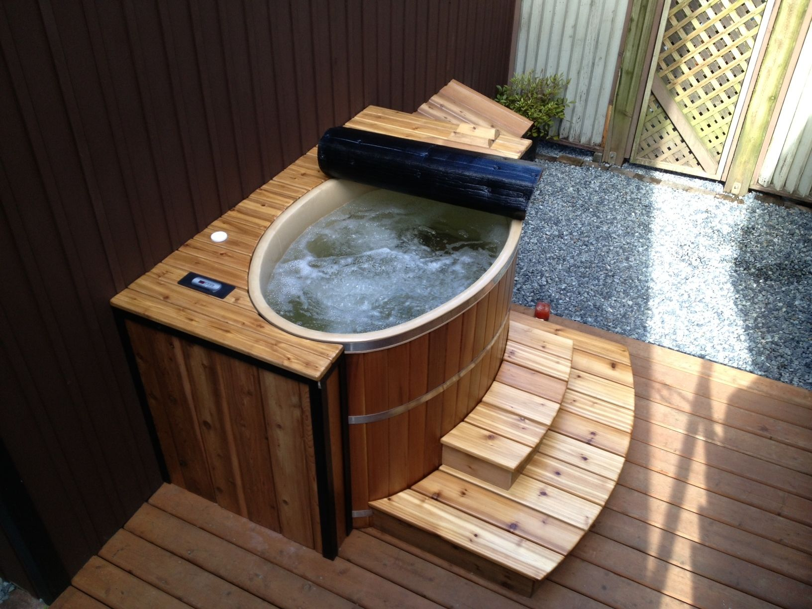 A 39 tub for 2 39 oval cedar hot tub is perfect for small for Oval garden tub