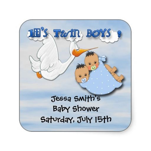 Features a light blue and pink gradient background, clouds and a stork carrying twin baby boys. The baby boys have dark hair and pacifiers i...