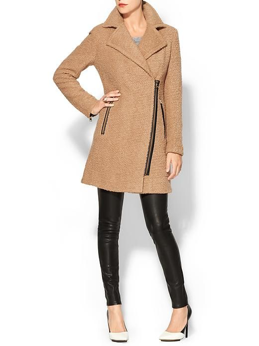 """Calvin Klein Wool Coat With Zipper Full length sleeves with zipper cuffs Oversized notched lapel Leather trim detailing Side zipper pockets Textured wool blend Asymmetrical zipper front closure Imported Model is 5'9, wearing a size 4 34 1/4"""" body length 33"""" sleeve length Body: 54% wool, 46% polyester. Lining: 100% polyester."""