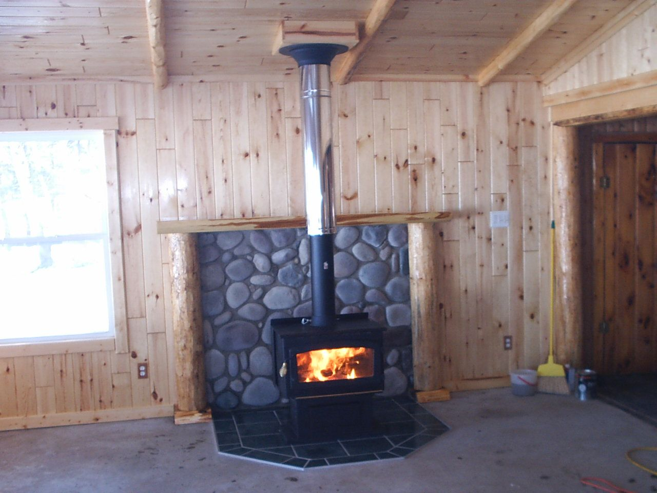 interesting woodstove mantle idea. Don't like the silver pipe but the rock  and · Mantle IdeasGas StoveBasement IdeasBasement ShelvingWood ... - 94 Best Images About Cabin Ideas - Woodstoves On Pinterest Wood