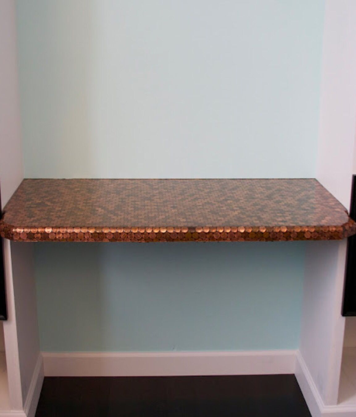Counter/table made of pennies.