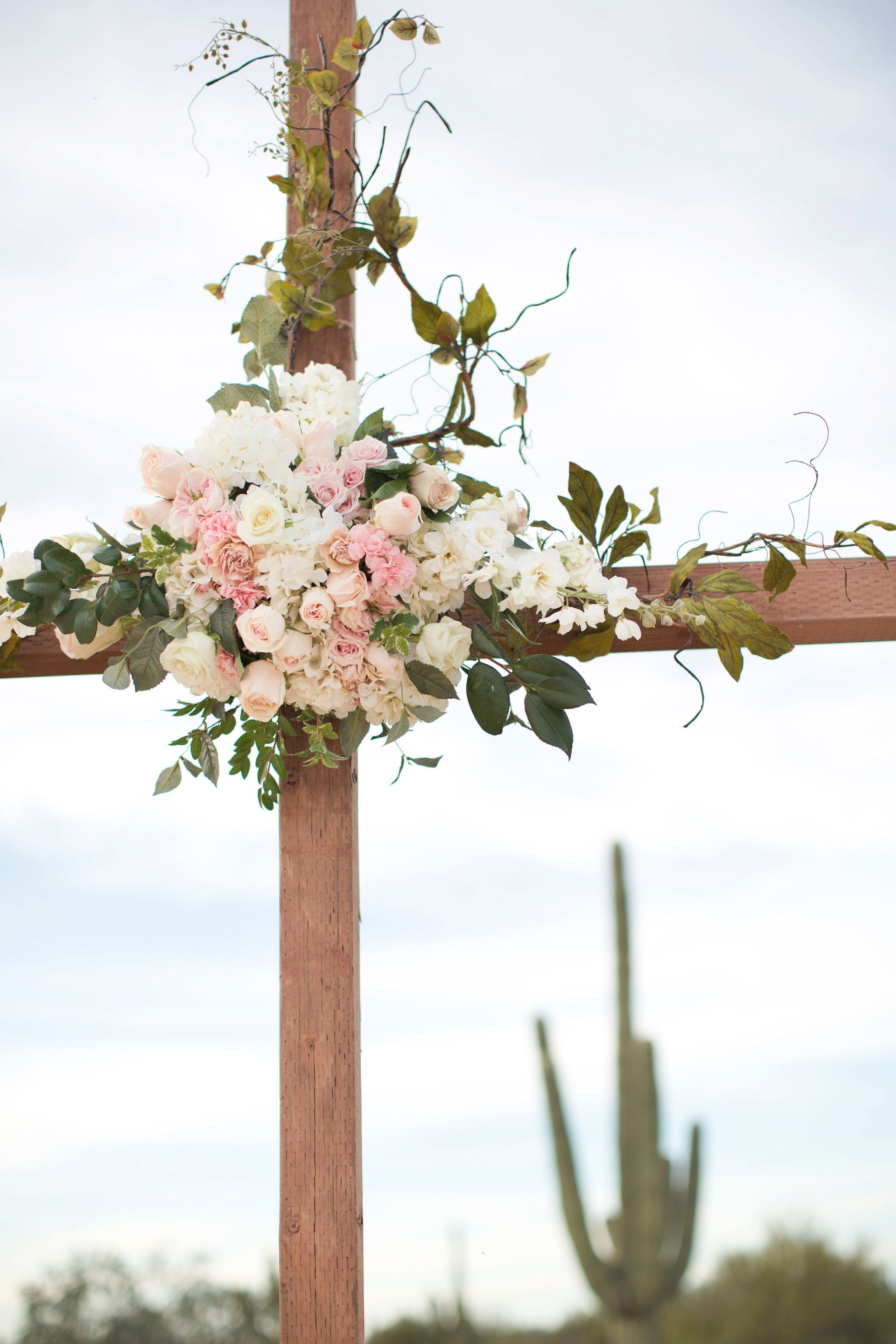 White Chairs, Wooden Cross, Decorated With Beautiful Florals Of White