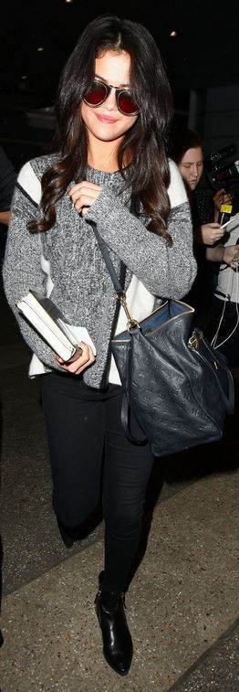 Who made  Selena Gomez's black handbag, ankle boots, sunglasses, and gray print sweater?