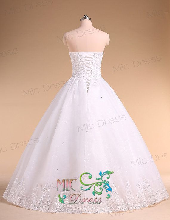 Sweetheart sleeveless floor-length organza with appliques and beads wedding dress