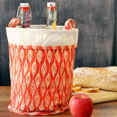 Leaf canvas buckets in tangerine $21 for large size {9 in. high} ... 100% recycled canvas cloth w/ soy-based inks = D