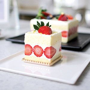 Strawberry shortcakes have gone through quite an evolution over the years: once distinctly characterised by its mix of shortbread, cream, and strawberries, sponge variations with whipped cream toppings have grown common. Often lighter and airier than their denser fruit cake cousins, strawberry shortcakes perfectly capture the holiday mood with their cheery colours. Here are our top 10 to add some festive joy to your Christmas celebrations.
