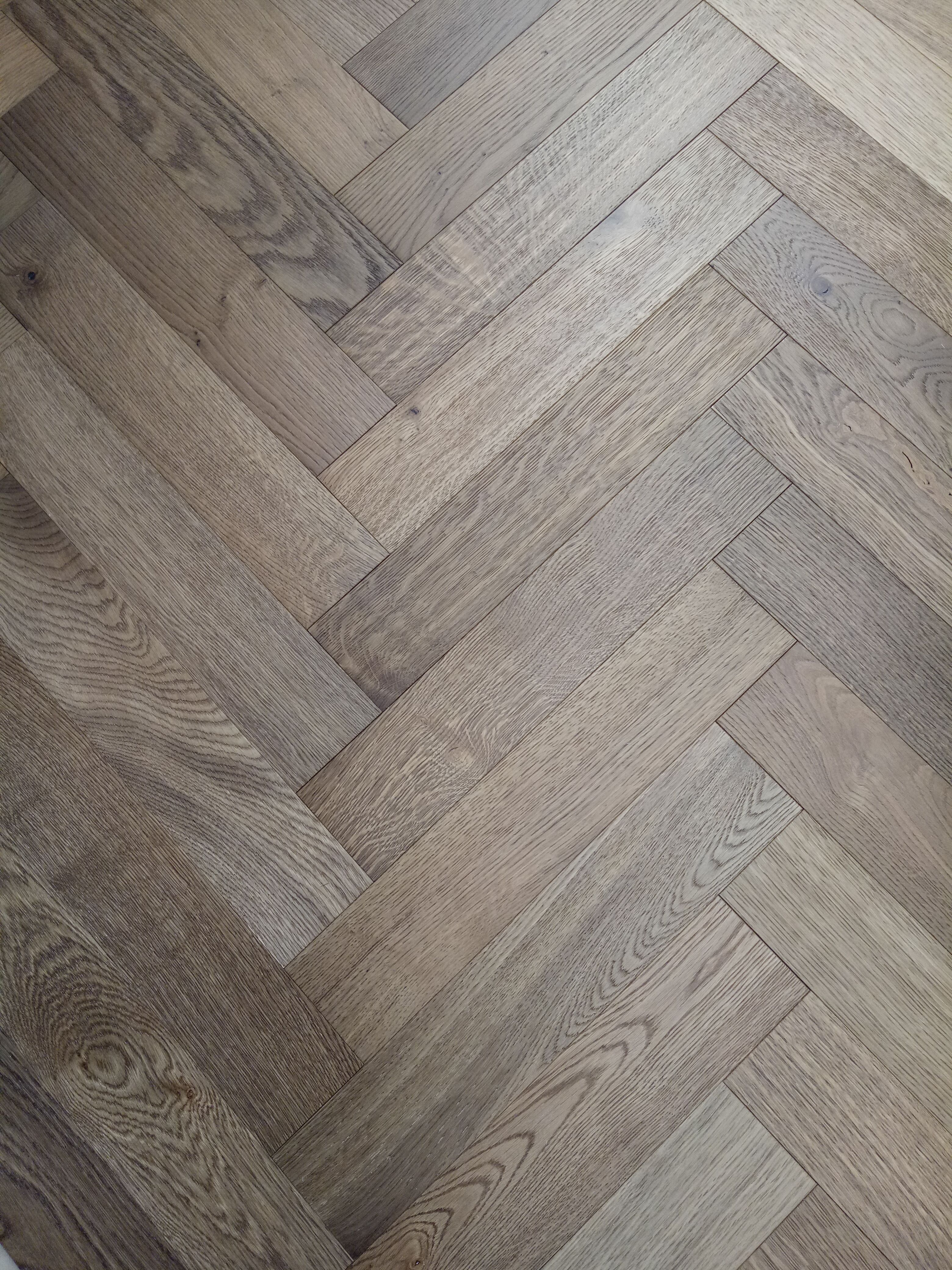 Grey garden engineered parquet herringbone flooring oak for Residential wood flooring