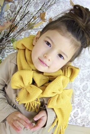 Over at Ruffles and Stuff we found this fantastic bow scarf tutorial. The author calls for using two scarves, which works if you have two identical scarves, or find two for fairly cheap
