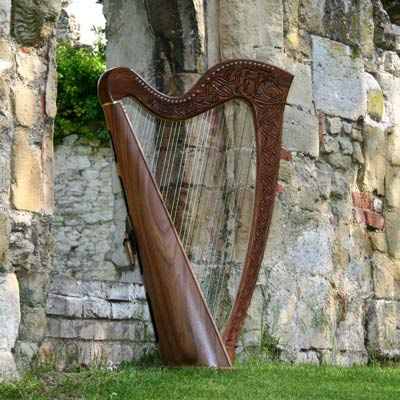 Celtic harp (also called the Gaelic harp or Clarsach), Irish origins.  Go to www.YourTravelVideos.com or just click on photo for home videos and much more on sites like this.