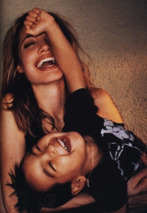 Angelina and child laughing