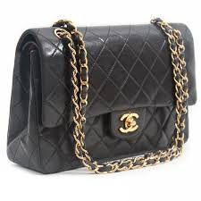 Chanel quilted black lambskin bag with gold chains