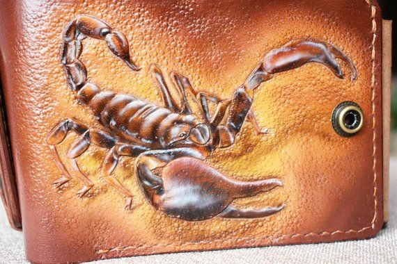 Photo of old wallet,billfold leather, carved wallet,wallets,billfold,wallet,billfold wallet,scorpion,leather wallet, carved billfold, bifold wallet