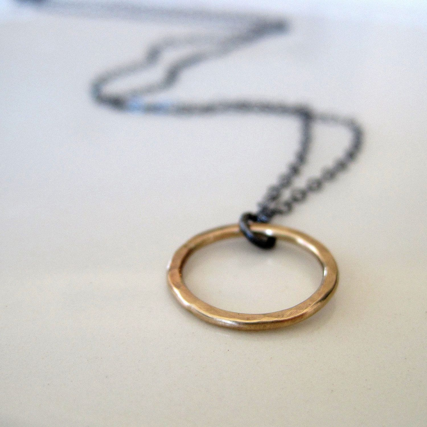 Hammered brass ring necklace on a sterling silver chain