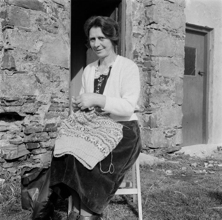 An image from the National Museums Scotland Collection. Mrs Helen Stout of the township of Busta, on Fair Isle, Shetland, knitting one of the jumpers for which the island is famous, about the 1950s. #Knitting #knit #Wool #Jumpers #WoollyWeekend