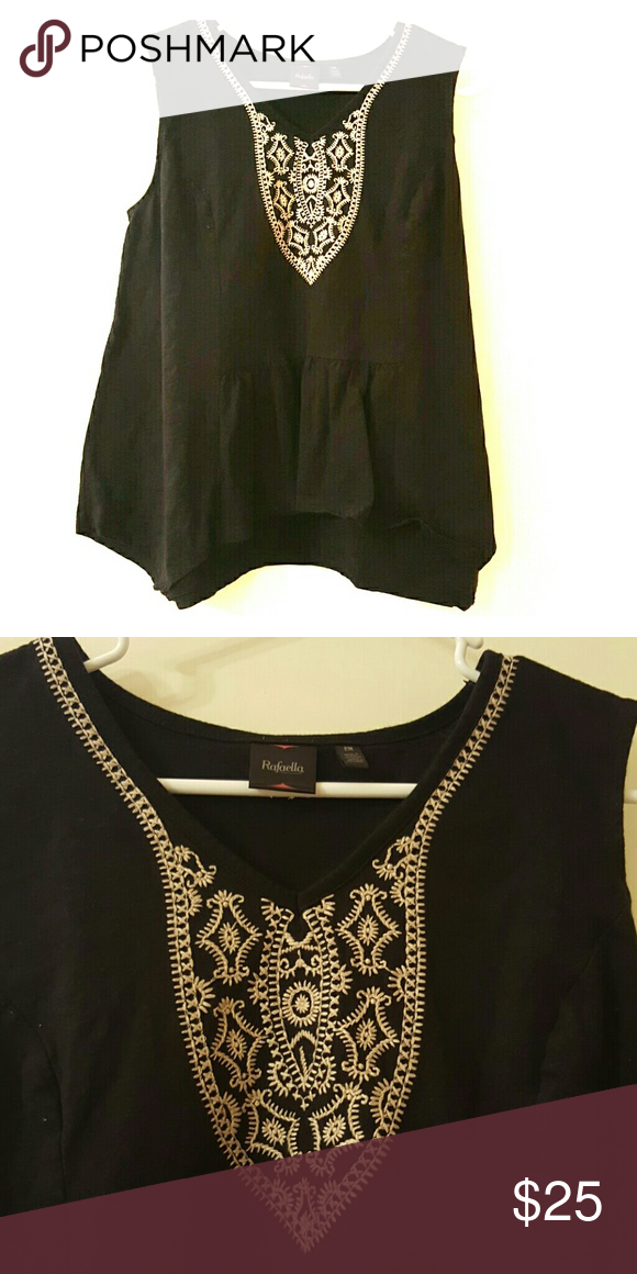 Comfy top Black casual top.with cream colored detail. Fits very loose. Never worn. Rafaella Tops Tees - Short Sleeve