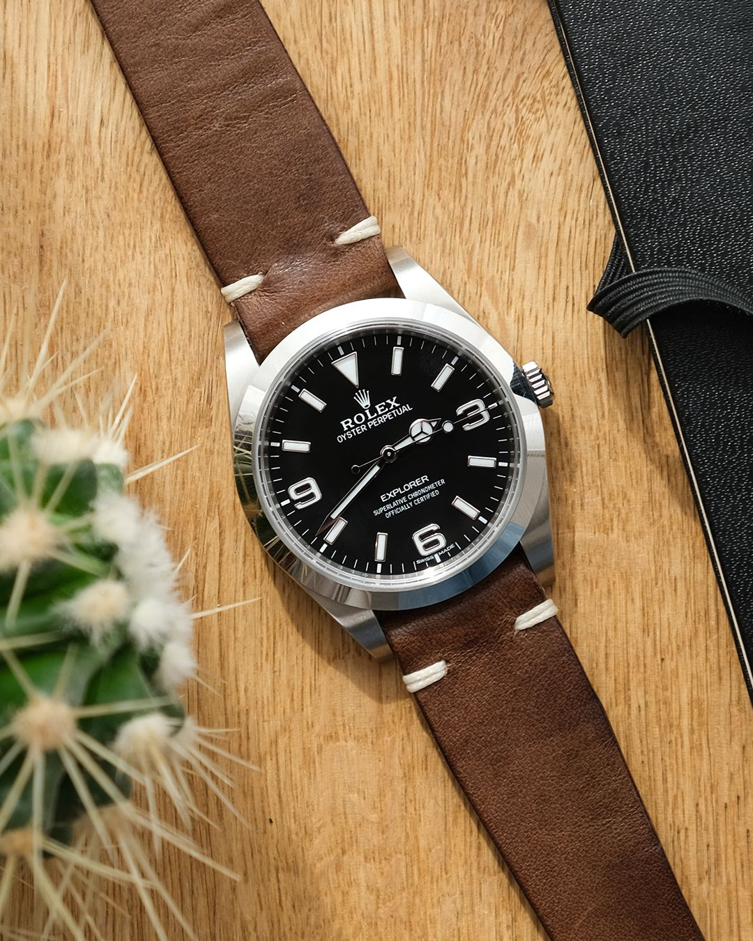 A modern 214270 Rolex Explorer on a brown leather strap