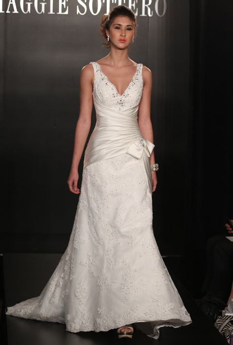 Maggie Sottero Spring 2017 Alaina Sleeveless Lace A Line Wedding Dress With Deep V Neckline Asymmetrical Satin Wred Waist And Bow Detail At The