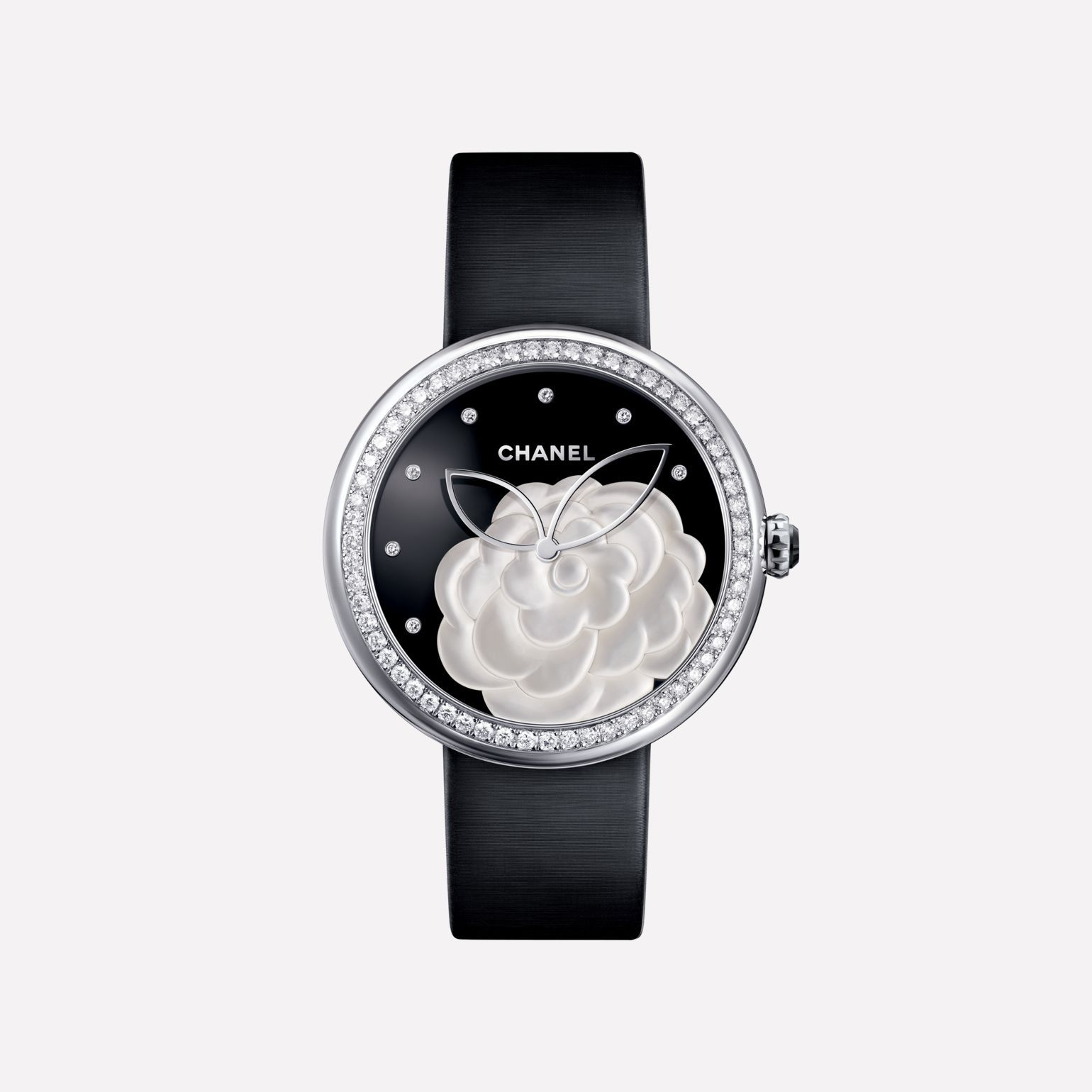 Discover the Mademoiselle Privé Watch - Pearl marquetry camellia, onyx dial, diamond indicators at the CHANEL Watches website