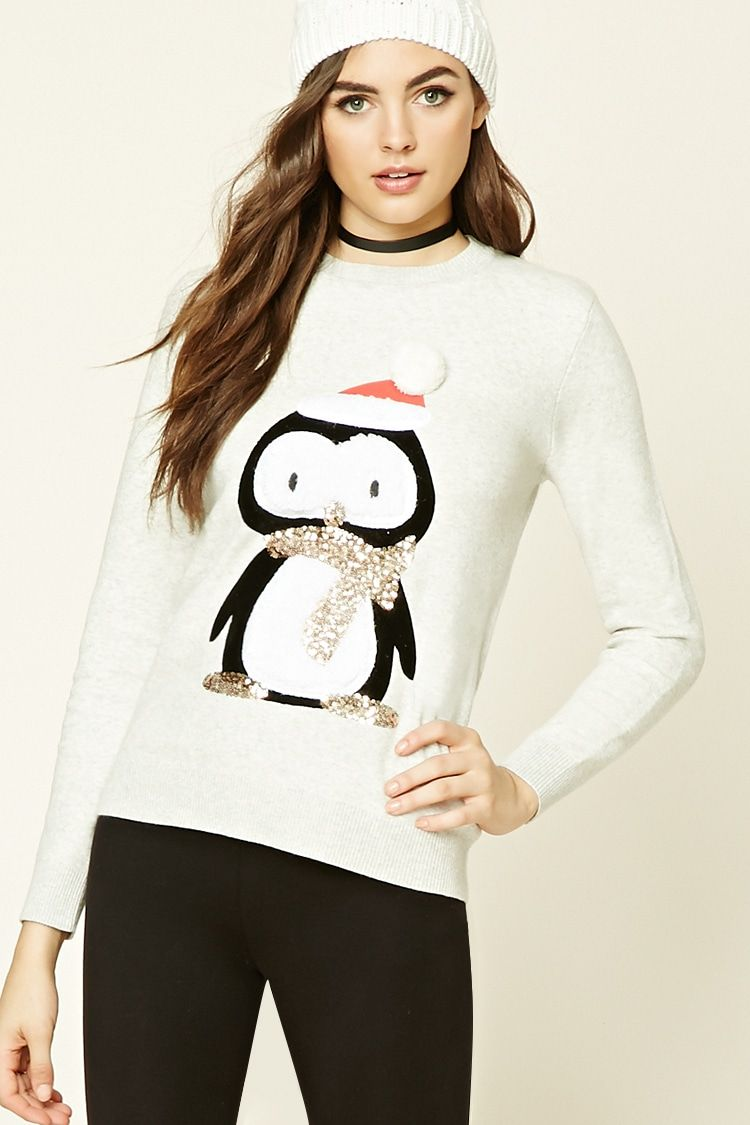 A heathered knit sweatshirt featuring an embroidered holiday penguin  graphic with sequins, a crew neck