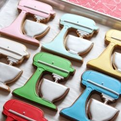 Gingerbread stand mixer cookies decorated with royal icing.