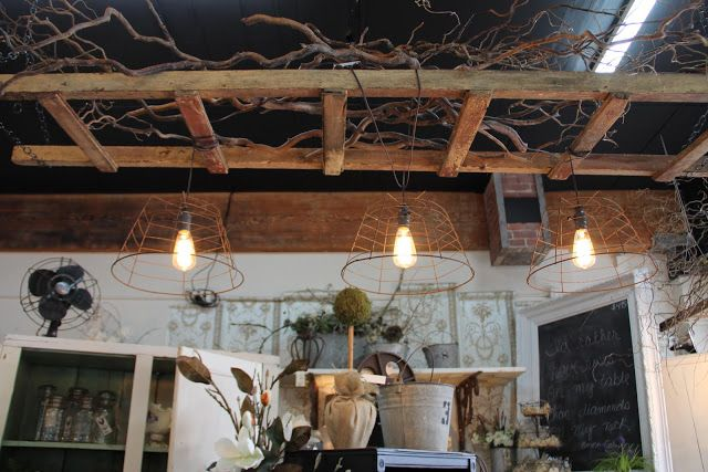 Hanging Ladder With Lanterns At Pottery Barn During Fall