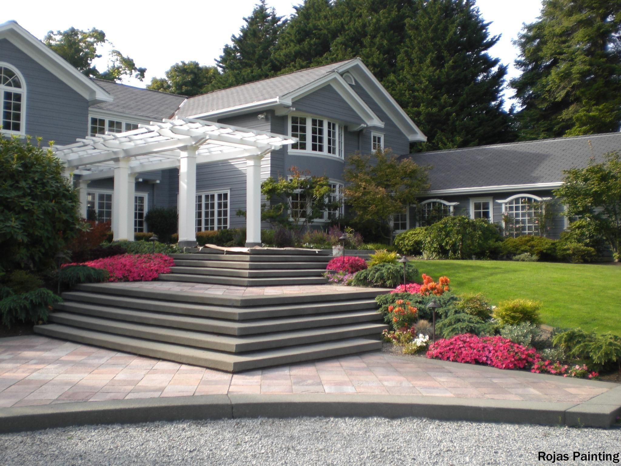 Traditional Home With Large Entry Stairs Multi Pane Windows White Columns Leading Up To The Door Tr Patio Pavers Design Traditional Patio Doors Patio Layout