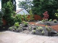 A garden created by Dennis Hopkins of  Northwest Botanicals  uses mulch, wood chips, bark and cedar chips for drainage.