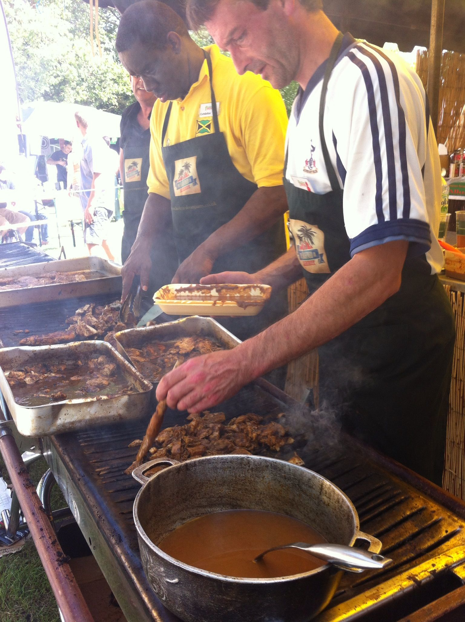 Jamaican jerk chicken stall at a food festival
