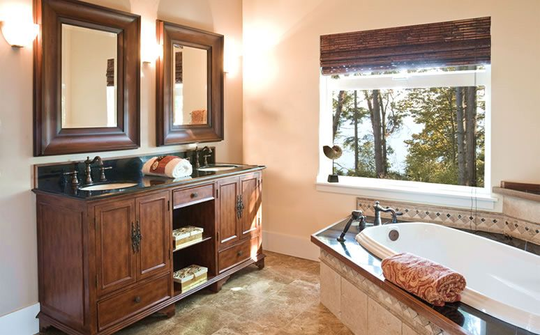 Casual bathroom. Big window. Large individual mirrors over double sink.
