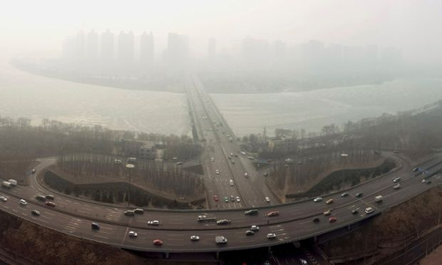 A panorama picture shot with a smartphone shows vehicles travelling on a highway viaduct near the Hunhe river in Shenyang. Photograph: Sheng Li/Reuters