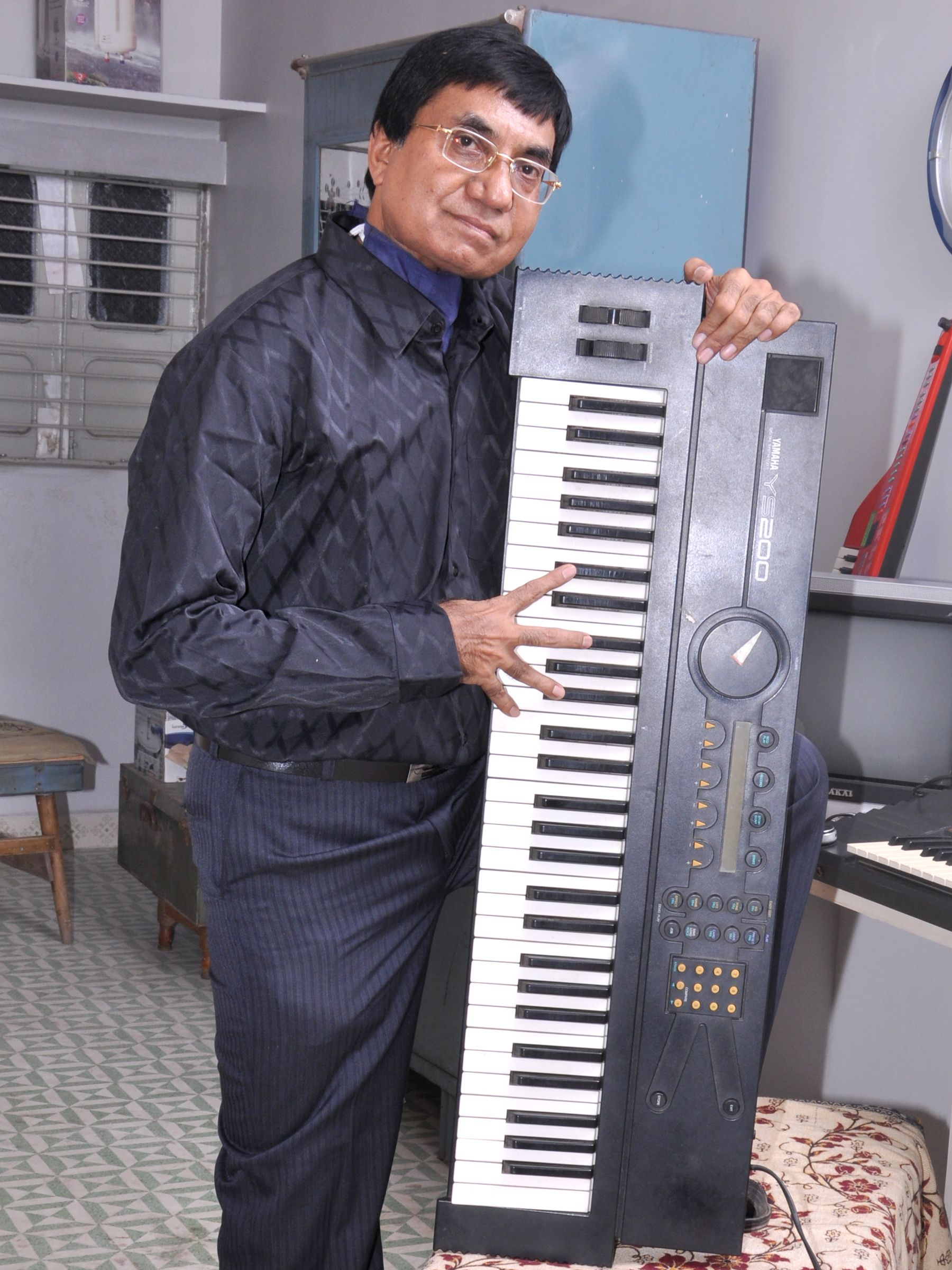 "Mr. Parshottam Solanki is a Keyboard player & Music director in his musical group ""TWINKLE STARS GROUP - India"".  And for contact, please visit to www.twinklestarsgroup.com"