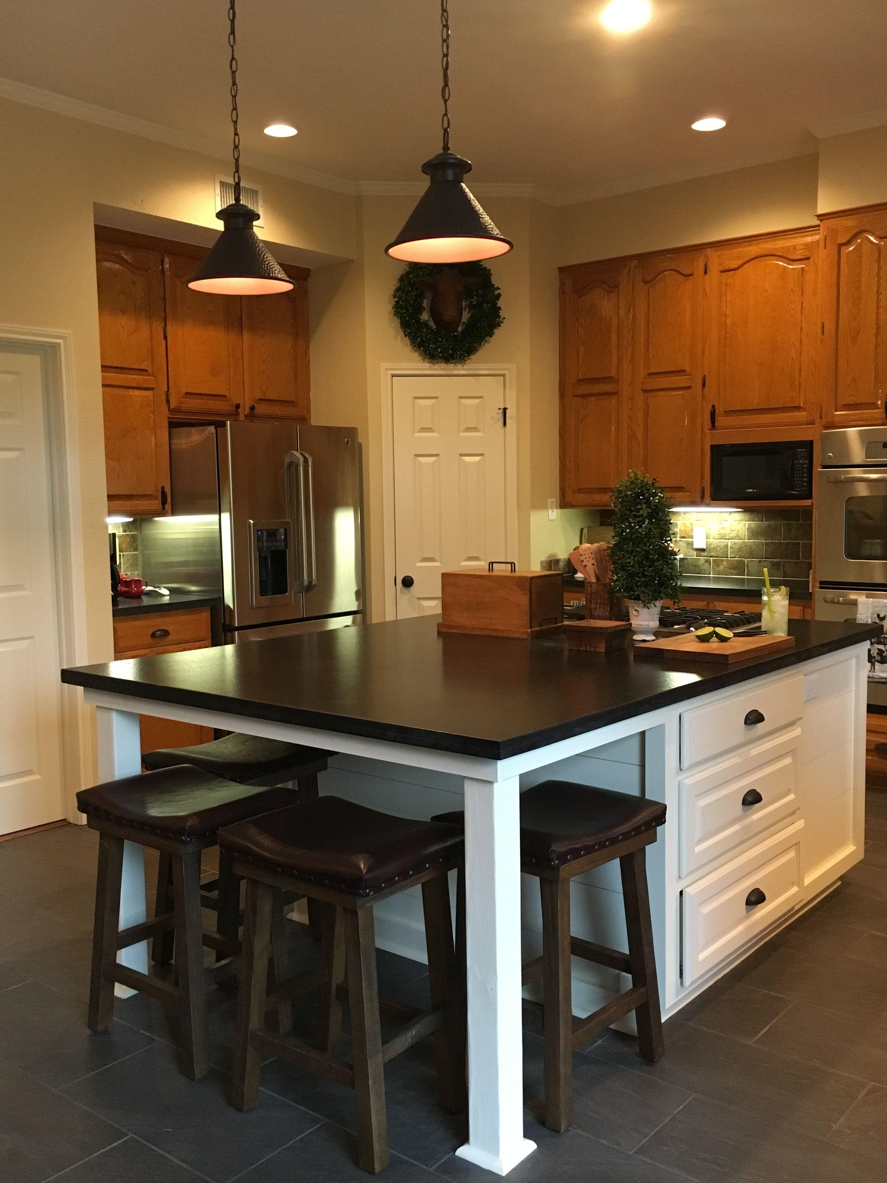 Updated kitchen with new white island, original honey oak ...