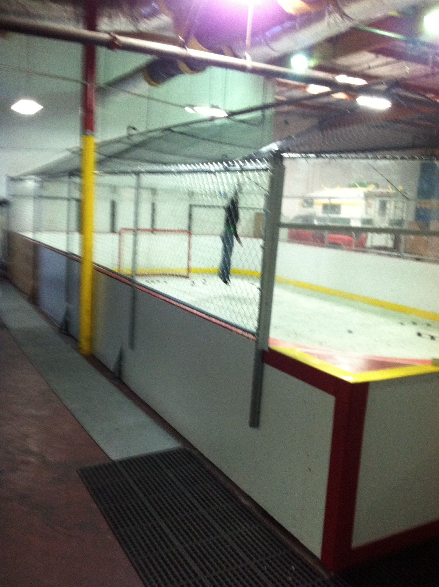 Fully enclosed faux ice rink ice rink basketball court