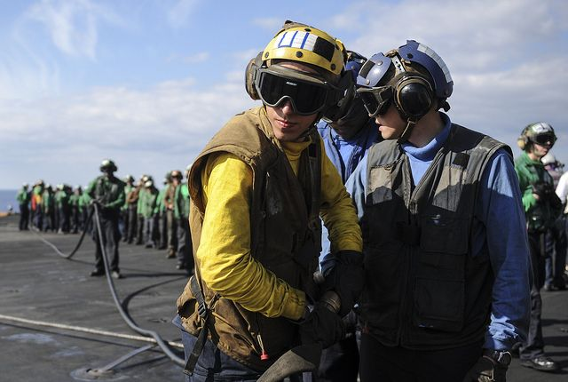 MEDITERRANEAN SEA (Oct. 21, 2013) Sailors and Marines fight a simulated fire on the flight deck of the aircraft carrier USS Nimitz (CVN 68) during a firefighting drill. Nimitz is deployed supporting maritime security operations and theater security cooperation efforts in the U.S. 6th Fleet area of responsibility. (U.S. Navy photo by Mass Communication Specialist Seaman Apprentice Kelly M. Agee/ Released)