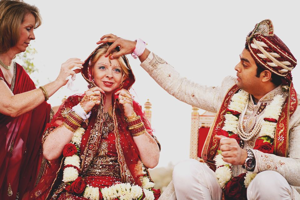 indian wedding photography design%0A Groom adorns bride with sindoor during Hindu wedding ceremony  The red  sindoor is a sign