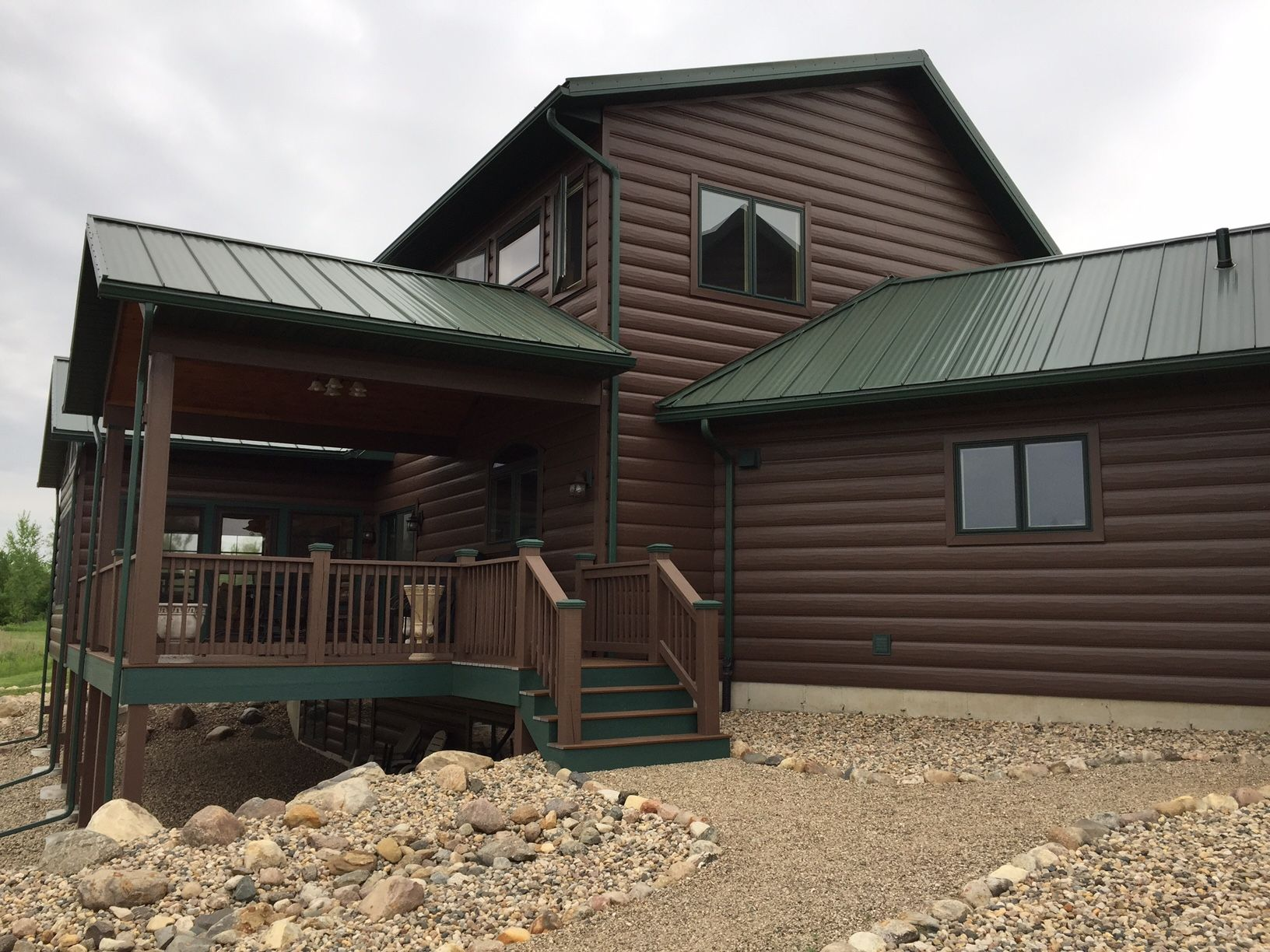 Autumn Brown Trulog Steel Siding With Green Roof Maintenance Free Log Cabin