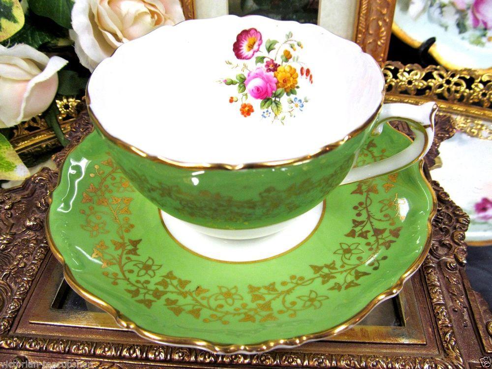 COALPORT TEA CUP AND SAUCER GOLD GILT LIME GREEN PATTERN TEACUP