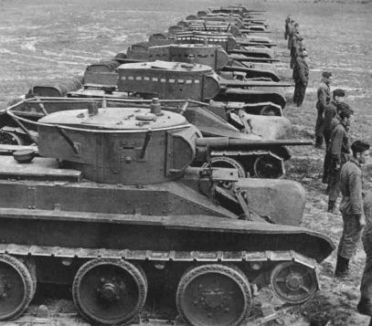 A column of Russian tanks fast BT-5 at the review. Notice the railing  antenna around the tower. Russian Tanks of World War II.