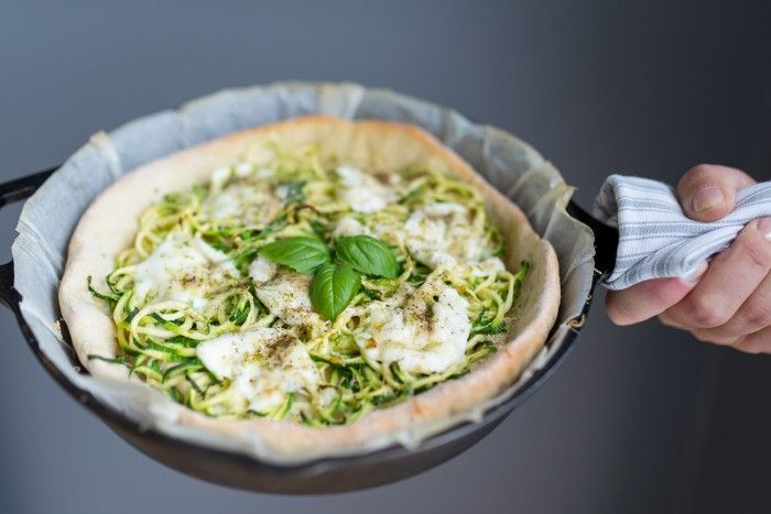 Learn how easy it is to make pizza dough at home. For a vegetarian option, top your pizza base with mozzarella, courgettes and lemon zest.