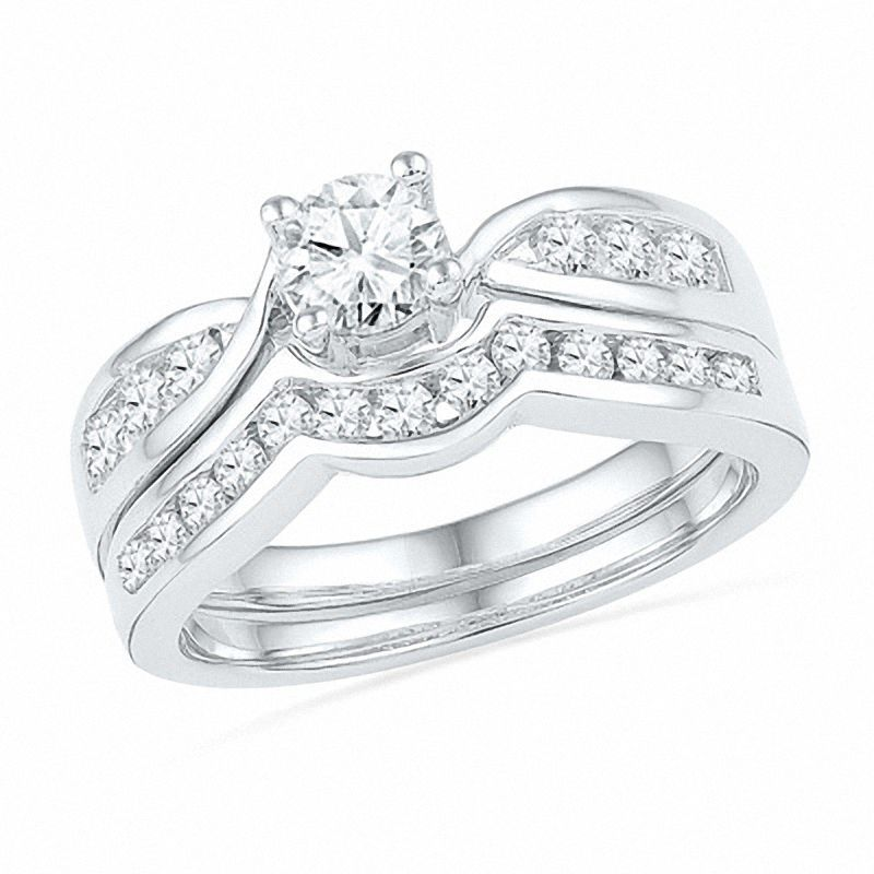 Express Your Love With This Classic Diamond Bridal Set Expertly Crafted In Cool Diamond Bridal Sets Engagement Rings Bridal Sets Engagement Wedding Ring Sets